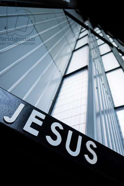 Jesus name in a catholic church, Paris, France, 2015 (photo)