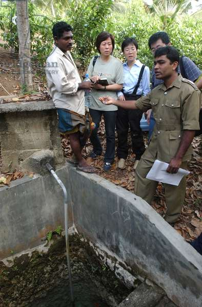 Chinese medical workers survey the source of drinking water in Hikkaduwa, a tsunami-stricken town some 90 kilometers away from Colombo, capital of tsunami-stricken Sri Lanka, Jan 5, 2005