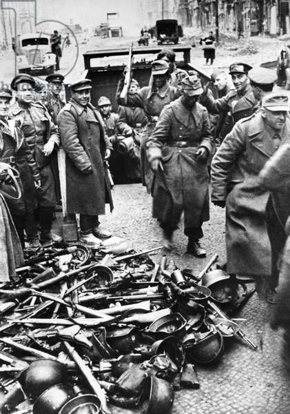 German Soldiers Surrendering their Weapons to Soviet Red Army Troops in Berlin, Germany, 1945.