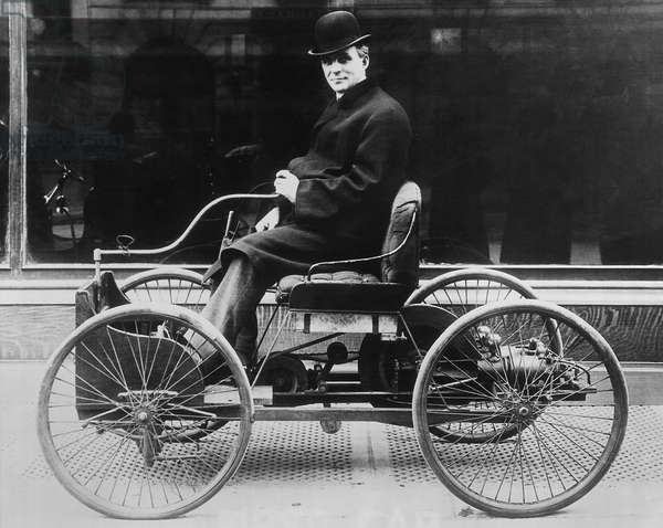 Henry Ford in his first automobile (b/w photo)