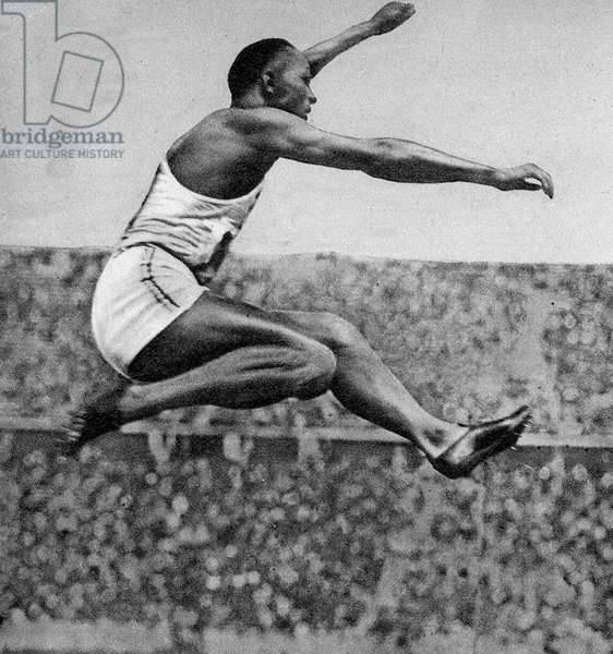 Jesse Owens (1913 - 1980) American track and field athlete. He participated in the 1936 Summer Olympics in Berlin, Germany, where he achieved international fame by winning four gold medals: one each in the 100 meters, the 200 meters, the long jump, and as