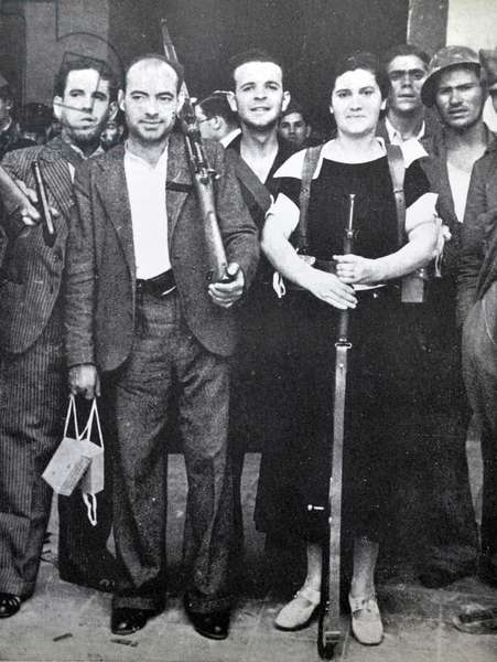 A female fighter with republican soldiers during the Spanish civil war, Barcelona 1937