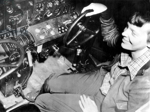 Amelia Earhart at control panel before test flight (b/w photo)