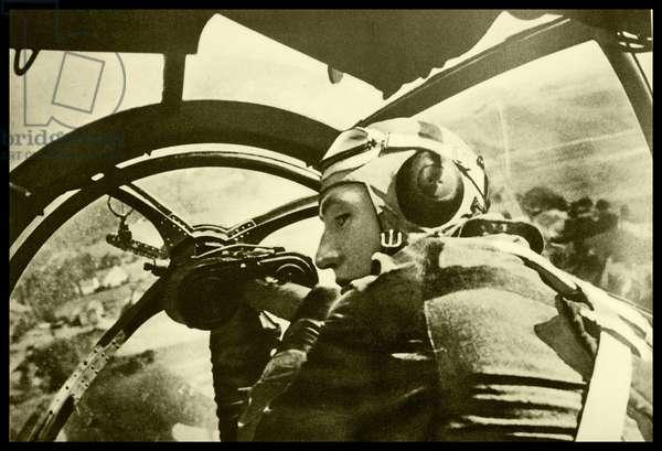 German solider in a plane, using mounted machine gun.