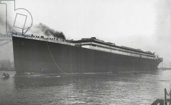 RMS Titanic Launched: Titanic afloat for the first time, but without engines, boilers, machinery and fittings, 31 May 1911 (b/w photo)