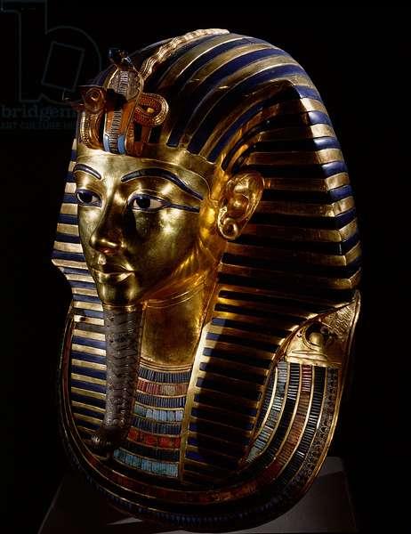 The mask of Tutankhamun. Full three-quarter view, 18th dynasty c.1357-1349 BC (gold, glass, semi-precious stones)
