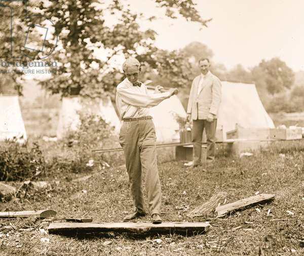 Henry Ford chopping wood 1921 (photo)