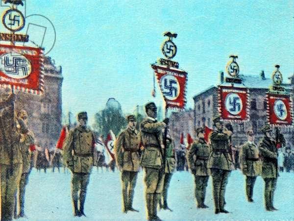 Standard bearers with Swastikas march, 1923, Munich