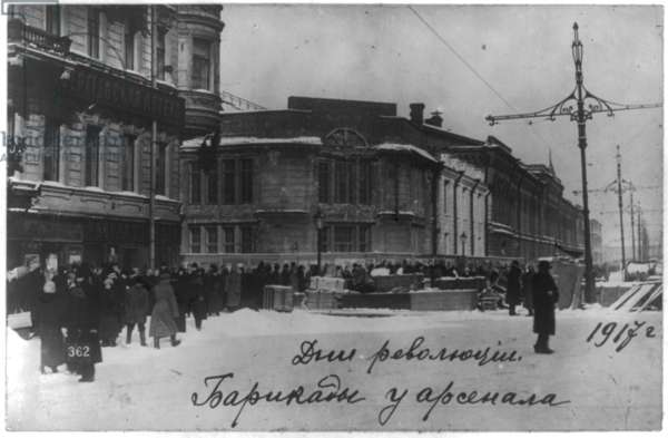 Russian revolution barricades at the Arsenal in Petrograd, 1917. people in front of a barricade on a street in Saint Petersburg