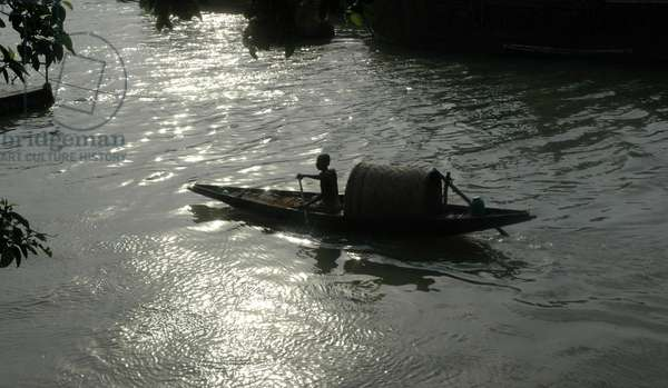 A fisherman at Outdrom Ghat in Kolkata, India. June 07, 2007.  (photo)
