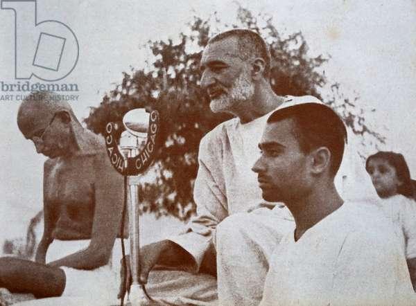 Mohandas Karamchand Gandhi at a prayer meeting as Khan Abdul Gaffar Khan addresses the audience