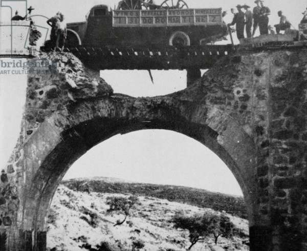 Nationalist troops cross a badly damaged bridge during the Spanish Civil War 1936