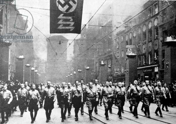 Adolf Hitler and the Nazis marching against the Treaty of Versailles.
