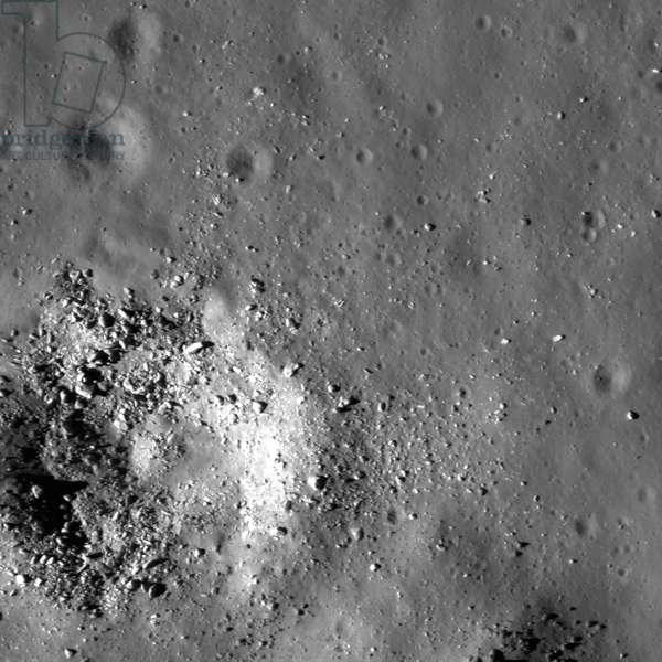 Much of the northwestern floor of Copernicus appears smooth and relatively featureless.