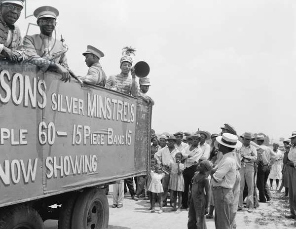 Colored minstrels advertising their show, 1942 (b/w photo)