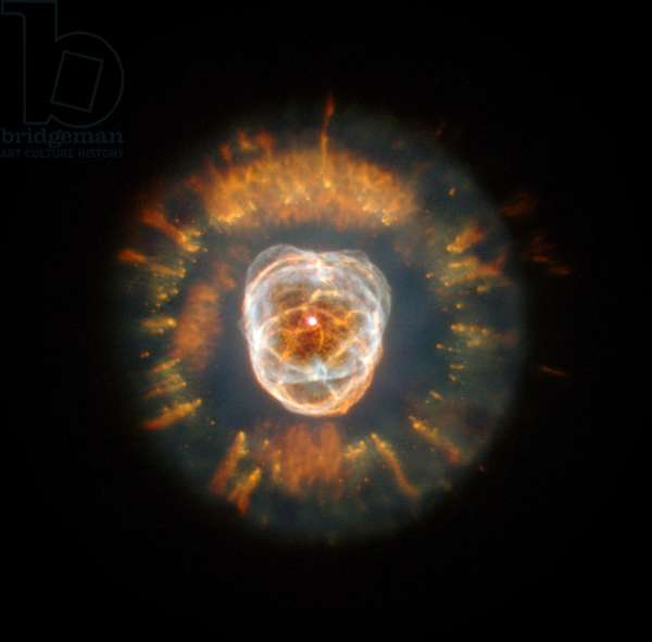 Eskimo Nebula, a planetary nebula, discovered by William Herschel in 1787. In 2000 the Hubble Telescope imaged the nebula which displays complex gas clouds that are not yet fully understood. Credit NASA. Science Astronomy Space