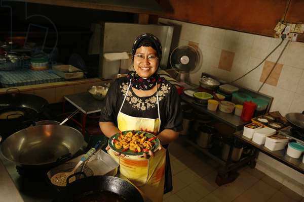 Housewife with Traditional Malaysian Food (photo)