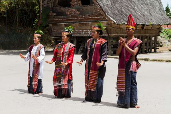 Toba Batak people performing a traditional Batak dance at Huta Bolon Museum in Simanindo village on Samosir Island, Lake Toba, North Sumatra, Indonesia (photo)