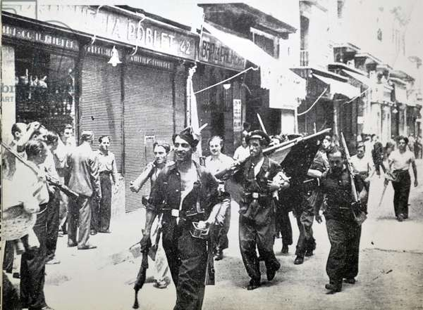 Enthusiastic republican fighters carry a captured flag during the Spanish civil war, Barcelona 1937