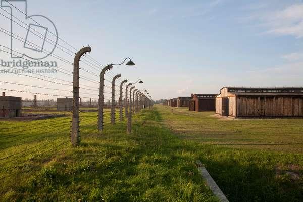 Electrified Barbed Wire Fence Along the Medical Barracks, Auschwitz-Birkenau Concentration Camp, Oswiecim, Malopolska, Poland (photo)