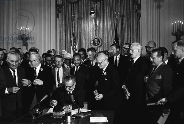 Lyndon Baines Johnson (1908 - 1973), referred to as LBJ, served as the 36th President of the United States from 1963 to 1969. Lyndon Johnson signing the Civil Rights Act, 2 July 1964. Martin Luther king Jnr. looks on behind the President