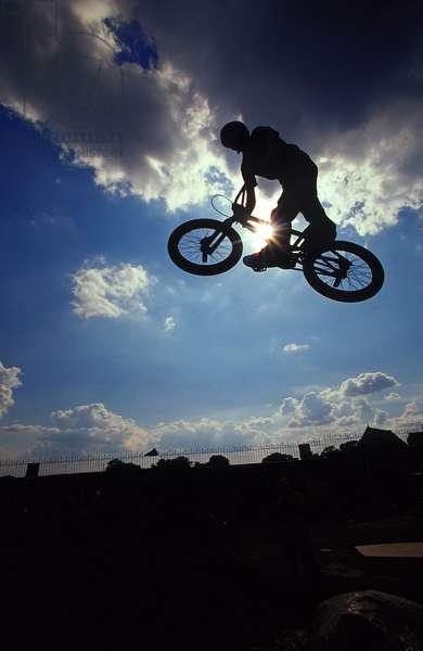 Silhouette, BMX tricks Back Yard Jam BMX event, Hastings UK