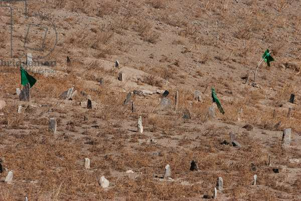 Flags Fluttering in the Wind Over A Muslim Cemetery at the Unai Pass (3,300 M), Vardak Province, Afghanistan (photo)