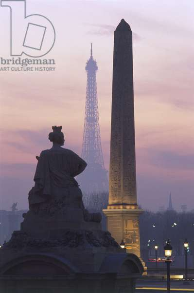 France, Paris, view of Obelisk of Luxor and Eiffel Tower at the Place de la Concorde by twilight.