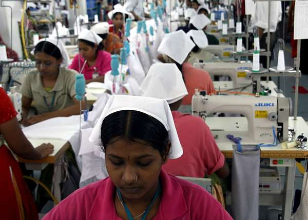 Female workers at a garments factory in Chittagong Export Processing Zone (CEPZ) in Chittagong, Bangladesh. November 22, 2008. Starting in 1976 the Ready Made Garment (RMG) sector in Bangladesh soon earned its reputation in the international market and now it is one of the main export oriented industries of the country. At present there are more than 2100 garment factories in the country employing more than 1.2 million workers and 85 percent of whom are women.  (photo)