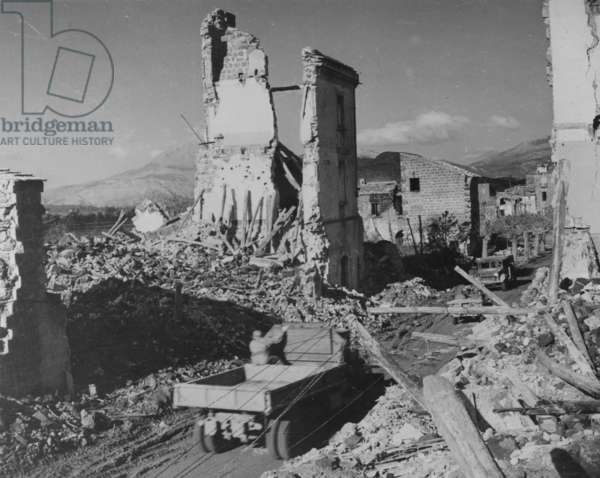 Vehicles Driving Through the Ruins of Cassino, 1942 (b/w photo)