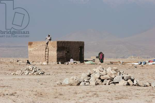 Man and Woman by A Brick House in the Outskirts of Kabul, Afghanistan (photo)