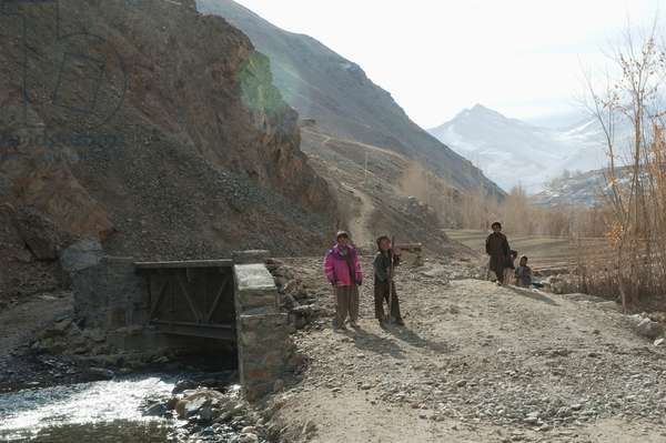 Boys Working on A Culvert Over A Stream in Aab-E-Noraq, Bamian Province, Afghanistan (photo)