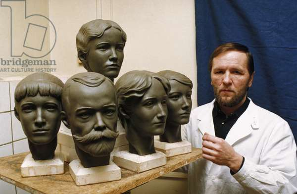 Dr, Nikitin with Sculptures of the Heads of Tsar Nicholas and the Romanov Royal Family Reconstructed from their Skulls, Moscow, Russia, 1996.