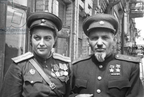 Twice Hero of the Soviet Union Major-General Sidor Kovpak and Hero of the Soviet Union Sniper Lyudmila Pavlichenko, 1944.
