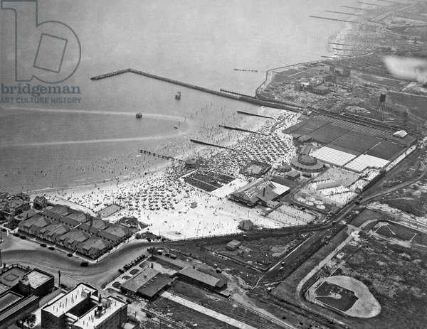 New York, July 4, 1925. An aerial view of Brighton Beach in Brooklyn on a crowded Fourth of July.  (b/w photo)