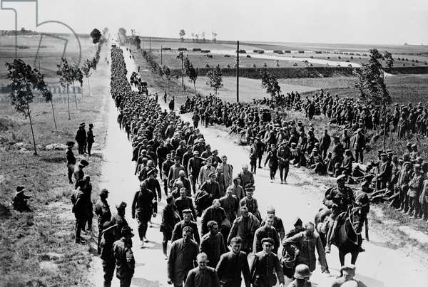 Official photographic print taken on the British Western Front in France. German prisoners in batches of 1,000 arriving at a prisoners of war cage.