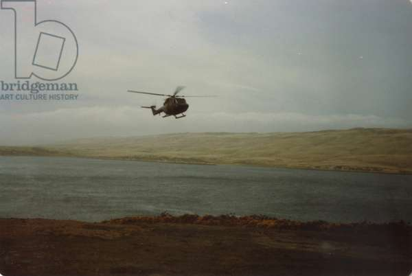 A Helicopter Flying Over the Falklands, 1982 (photo)