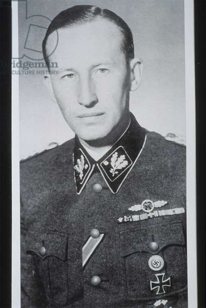 Reinhard Heydrich (1904-1942) SS-Obergruppenfuhrer, chief of the Reich Security Main Office (including the Gestapo, SD and Nazi police agencies) and Reichsprotektor (Reich Protector) of Bohemia and Moravia. Heydrich chaired the 1942 Wannsee conference, which finalized plans for the extermination of all European Jews in what is now referred to as the Holocaust. Heydrich was wounded in an assassination attempt in Prague on 27 May 1942 and died over a week later from complications arising from his injuries.
