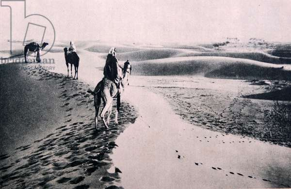 North African Arabs cross the Sahara desert by camel 1930