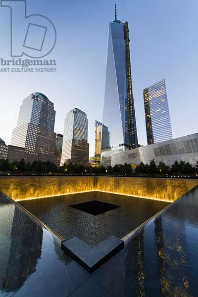 The National September 11 Memorial and One World Trade Center at night, New York City, New York, United States (photo)
