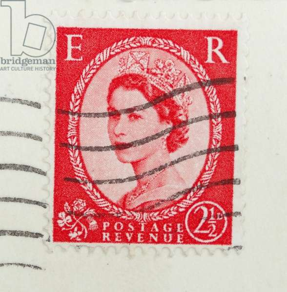 Queen Elizabeth II as she appeared on an  English postage stamp circa 1958.