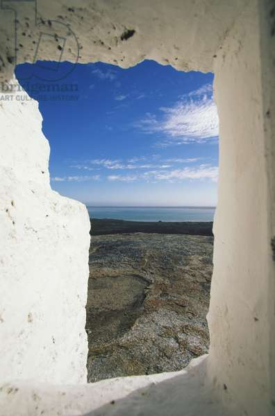 South Africa, Langebaan, Seesig Lookout, view through whitewashed window of sunny blue sky and sea in distance.