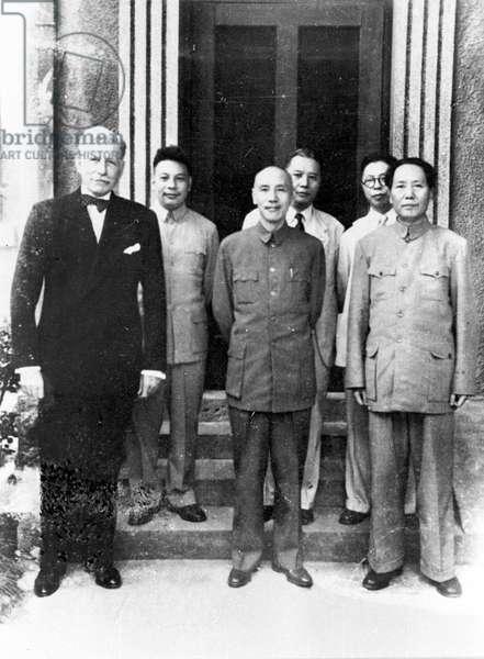 Chiang Kai-shek, center, and Mao Zedong, right, with US Ambassador to China, Patrick J Hurley, China