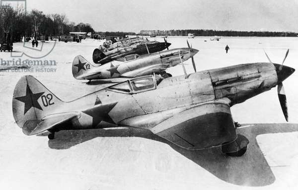 World War 2, Soviet Air Force Mikoyan-Gurevich Mig-3 (I-18) Fighters in Winter Camouflage on a Snow Covered Airfield on the Soviet/German Front, Defense of Moscow, 1942.