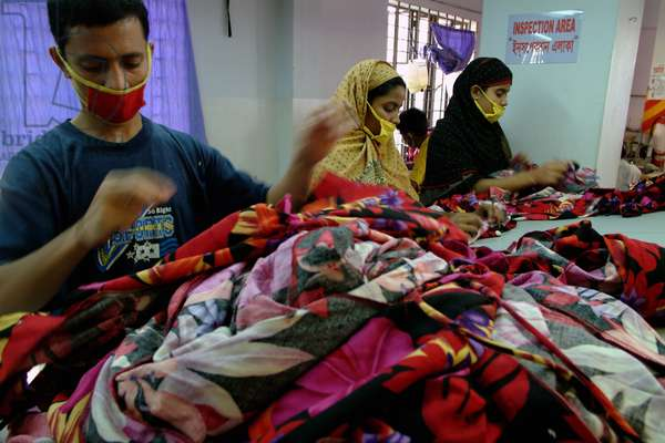 Workers inside an RMG (Readymade Garments) factory. Garments sector contributes the highest to the GDP of Bangladesh. Bangladesh. November 15, 2002.  (photo)