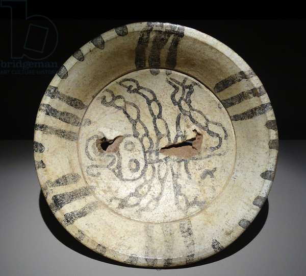 Cream, polychrome plate decorated with a scorpion