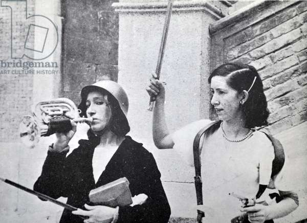 These two female republican fighters taking a moment to celebrate during the Spanish civil war, Barcelona 1937