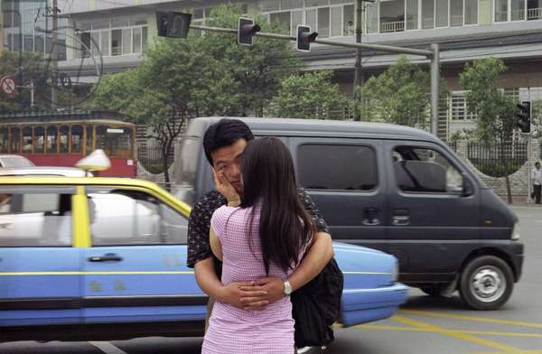 Young couple embracing in the street - Chengdu - Sichuan Province, China