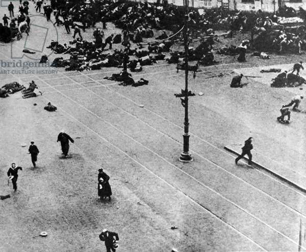 Russian Revolution: Street fighting in Petrograd (St Petersburg) send s civilians running for safety