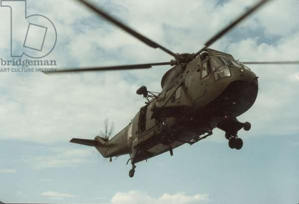 A Helictopter Flying Over the Falklands, 1982 (photo)
